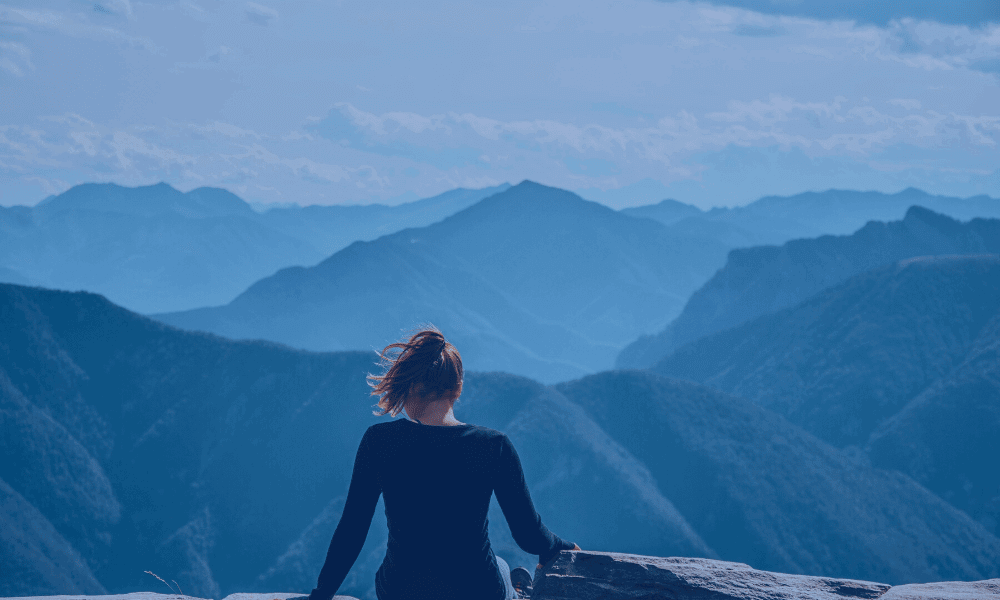 SYBD Woman on a mountain top